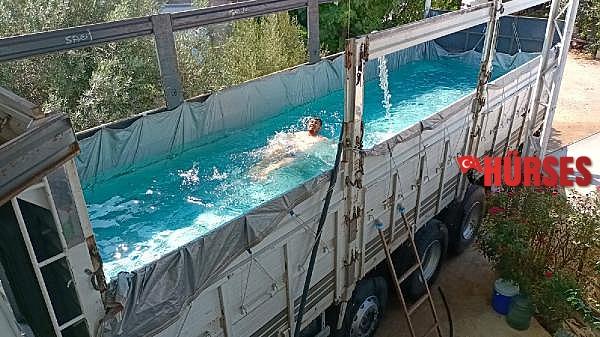 2021/07/sicaktan-bunaldi-kamyonunu-havuza-cevirdi-2eccaf78413c-3.jpg