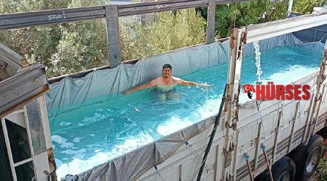 Sıcaktan bunaldı, kamyonunu havuza çevirdi
